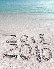 New 2016. The wave washes off an inscription 2015...