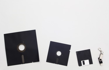 Floppy disks and a flash drive depicted as an evolutionary trend