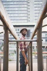 Knee figure of young handsome afro black man posing outsuide in