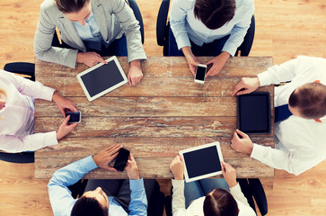 business team with smartphones and tablet pc