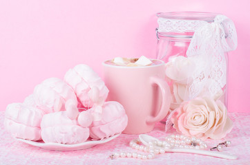 Cute set of pink princess accessories and sweets. Bottle with mastic flowers, big peach rose, zefir, cup of cacao with marshmellow, little spoon and pearl jewerly.