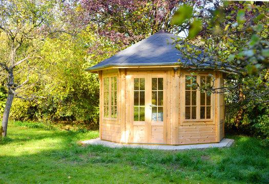 Wooden garden pavillion in beautiful light