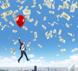 businessman jumping, money rain