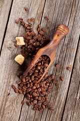 Coffee beans and brown sugar on wooden table