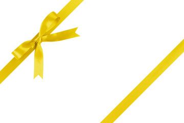 yellow ribbon with bow for packaging with tails isolated on white