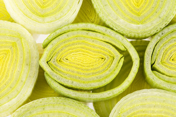 background of sliced leek rings , close up
