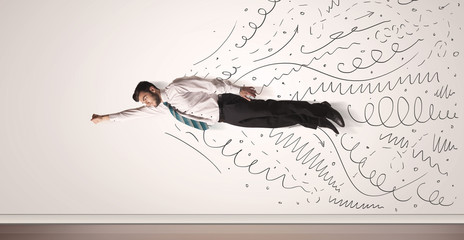 Business man flying with hand drawn lines comming out