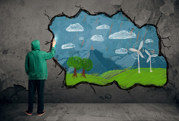 Young urban painter drawing