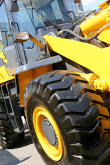Yellow bulldozer with big wheels