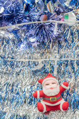 Santa Claus on tinsel  background