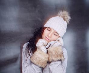 Portrait of brunette woman in winter hat.