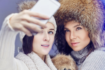 Two women in winter clothes.