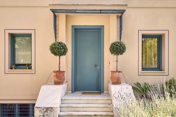 contemporary house facade with flowerpots, Athens Greece