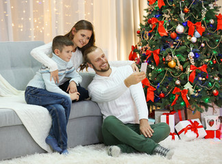 Happy family making photo in home holiday living room