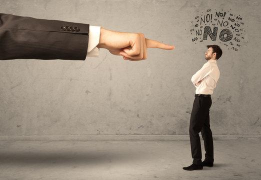 Boss hand guiding beginner salesman
