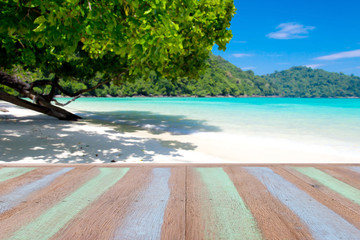 Plank wood or table top with blurred seascape : Suitable use for montage or display your product.