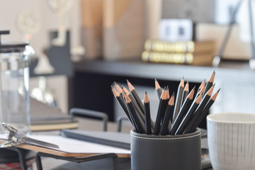 black pencils on working table at home