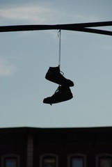 Hanging pair of shoes on a wire