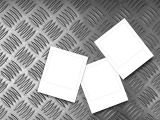Three square frames on metal pavement background