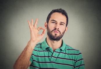 Everything is OK! Happy young man gesturing OK sign