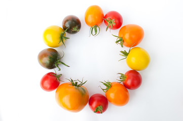 Colorful tomatoes Fresh colorful tomatoes on a white background. Yellow, red, pink, orange and black tomatoes.