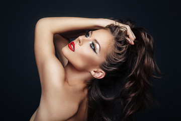 Portrait of beautiful woman with nice makeup and curly hairstyle