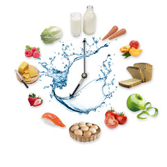 Clock arranged from healthy food products splash by water isolated on white background. Healthy food concept.
