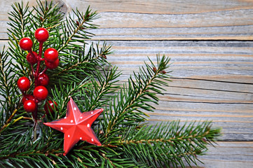 Christmas background with spruce branches and red Christmas decorations