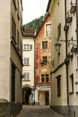 a narrow historic street in the old part of of city of Chur.