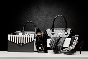 beautiful set of women's fashion accessories on black background