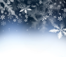 Christmas Time. Christmas Abstract background. .Falling snowflakes on blue abstract sky. Free space for your Christmas and New Year wishes - felicitation.