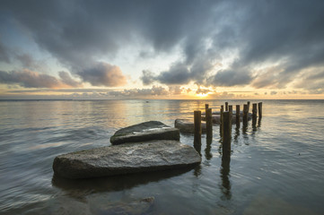 stone pier on the sea