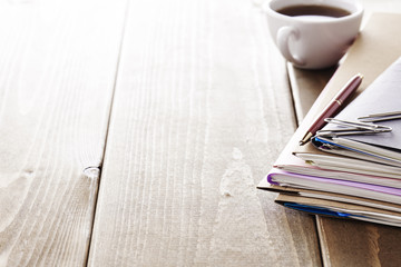 Files. Office supplies on wooden desk.