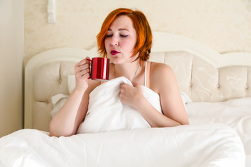 Woman in Queen Size Vintage Bed drinking Morning Coffee