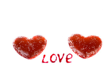 """Two red hearts on a white background and the words """"Love""""."""