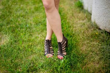 Legs of girl in sandals