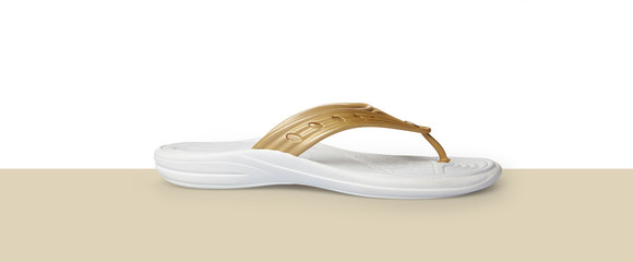Gold and white flip flops