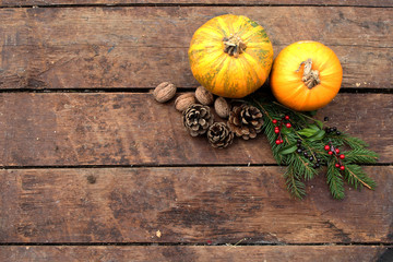 Pumpkin on wooden background - Halloween, Christmas and Thanksgiving concept - decoration and copy space