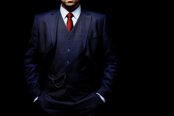 man in suit on black background
