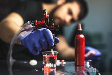 Tattooist makes a tattoo. Closeup