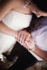 Bride and groom holding hands. Wedding.