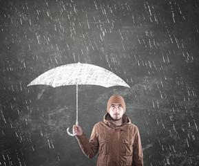 Young man under an umbrella