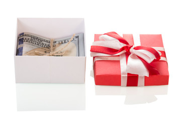 Dollar banknotes in gift box