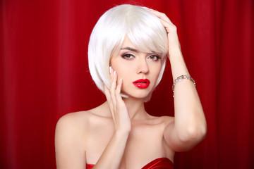 Blond bob hairstyle. Make-up. Beautiful sexy Girl Face Close-up.