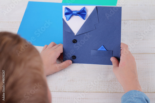 child making greeting card for father handmade dad happy birthday card happy fathers day card kids art handmade new year and christmas greeting cards
