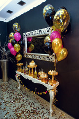 stylish luxury decorated candy bat with balloons at the golden b
