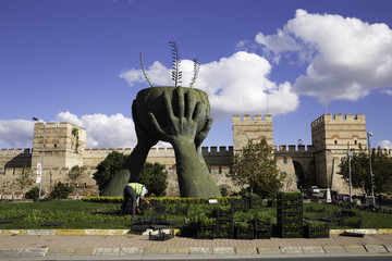Peace and Culture Statue and ruins of ancient fortress wall of the Belgradkapi