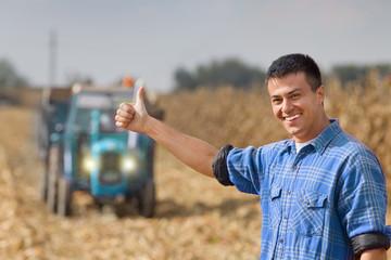 Satisfied farmer on farmland