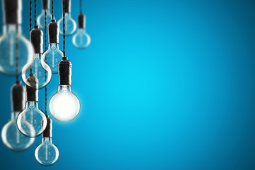 Idea and leadership concept Vintage  bulbs on color background,