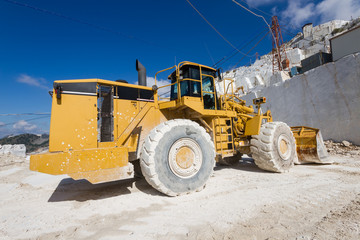 Excavator in a white marble quarry of Carrara, Tuscany, Italy